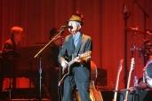 Leonard Cohen playing guitar