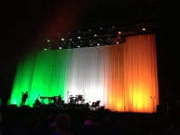 Curtains lit in the colours of the Irish flag (green, white and orange) before Leonard Cohen's Dublin show