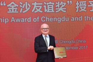 John receiving Chengdu Jinsha Friendship Award
