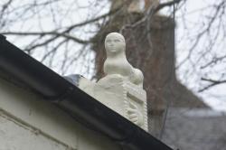 Sphinx (?) on roof