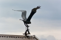 Bird sculpture on the roof